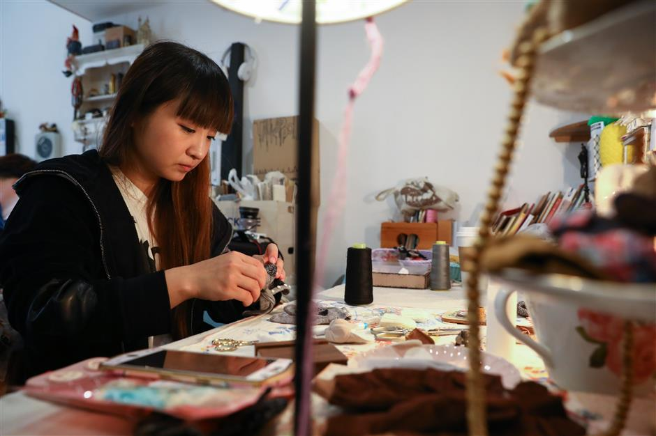 A designer and dressmaker who thrives in a very small world