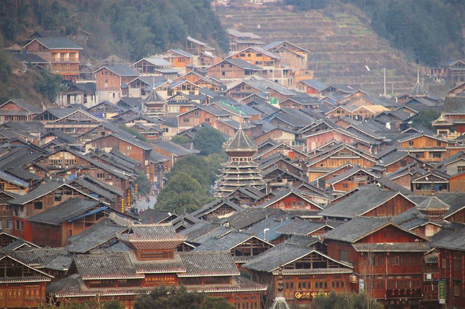 Atop stone pillar, Buddhist temples reach for the sky
