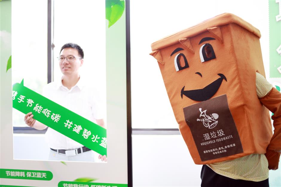 Government officials go all in on garbage sorting