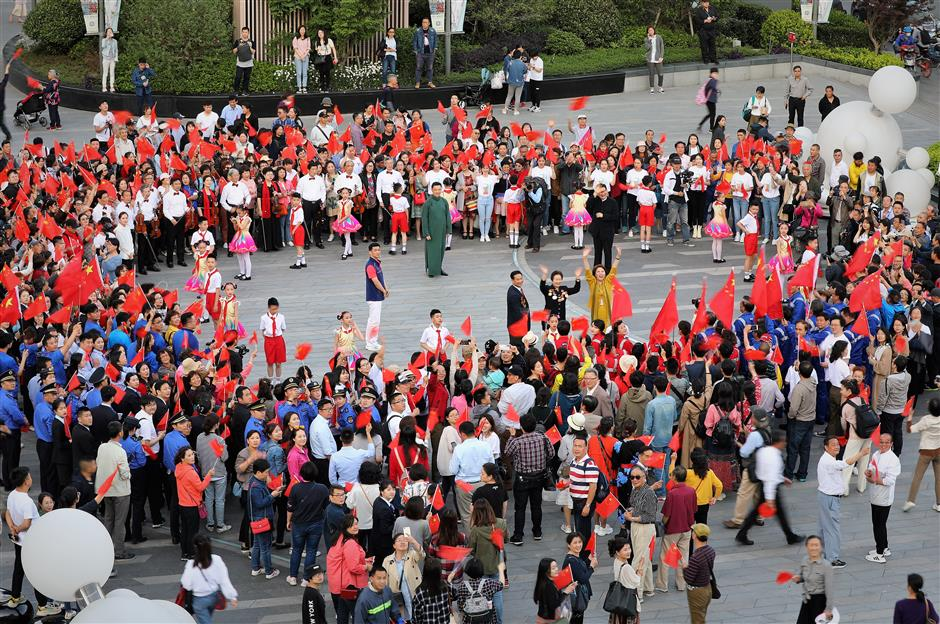 'My Country and I' flash mob rocks North Bund