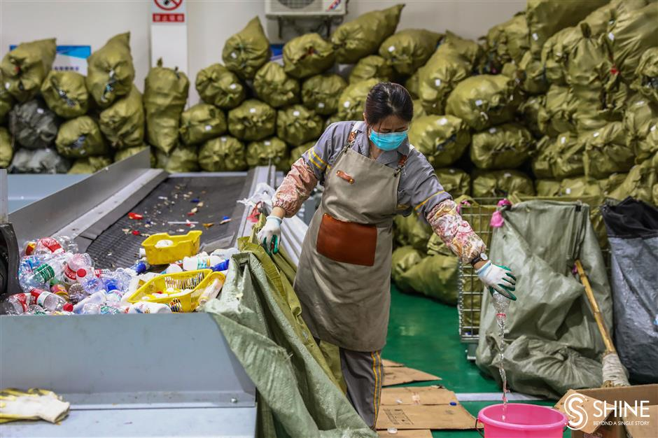 Tons of recyclables sorted by hand in Jiading center