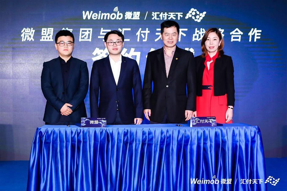 Two high-tech firms partnering to serve booming digital merchant market