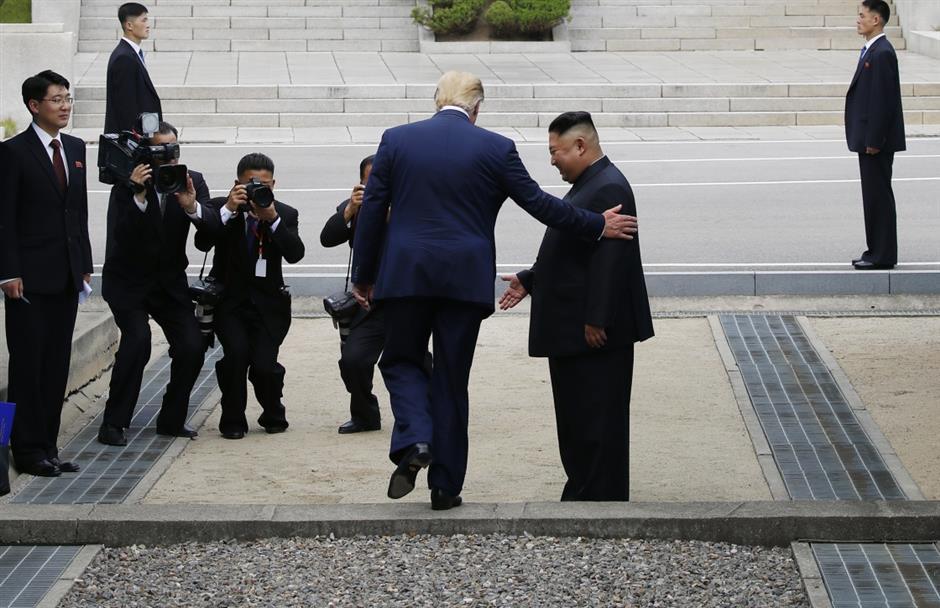 Trump crosses inter-Korean border as 1st sitting US president