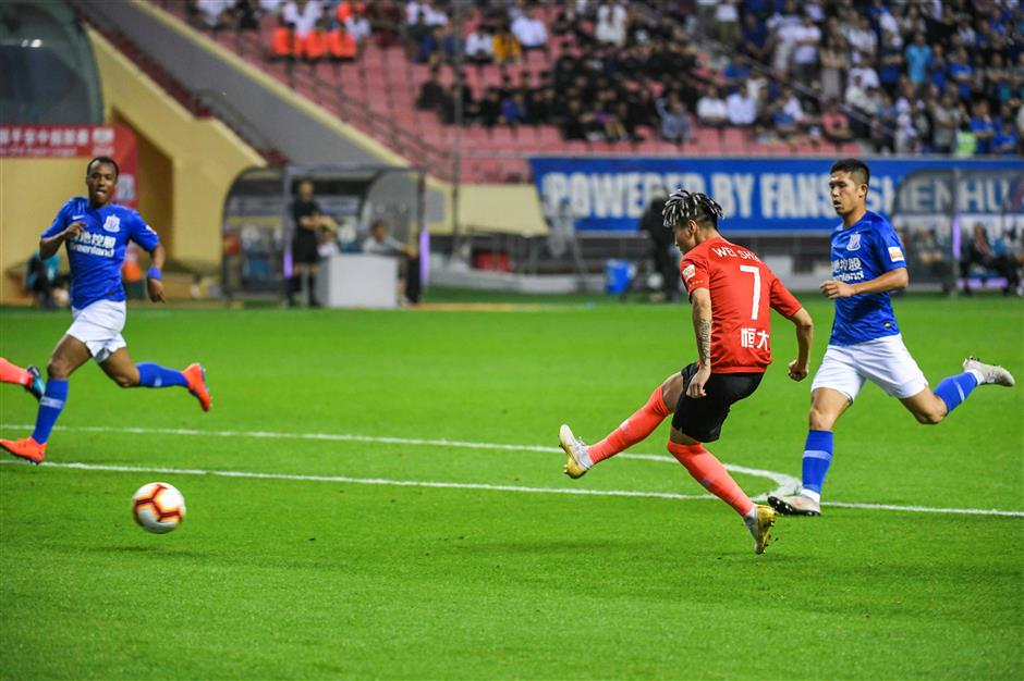 Evergrande goes joint second with Shenhua win