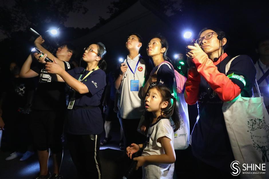 Students explore botanical garden at night