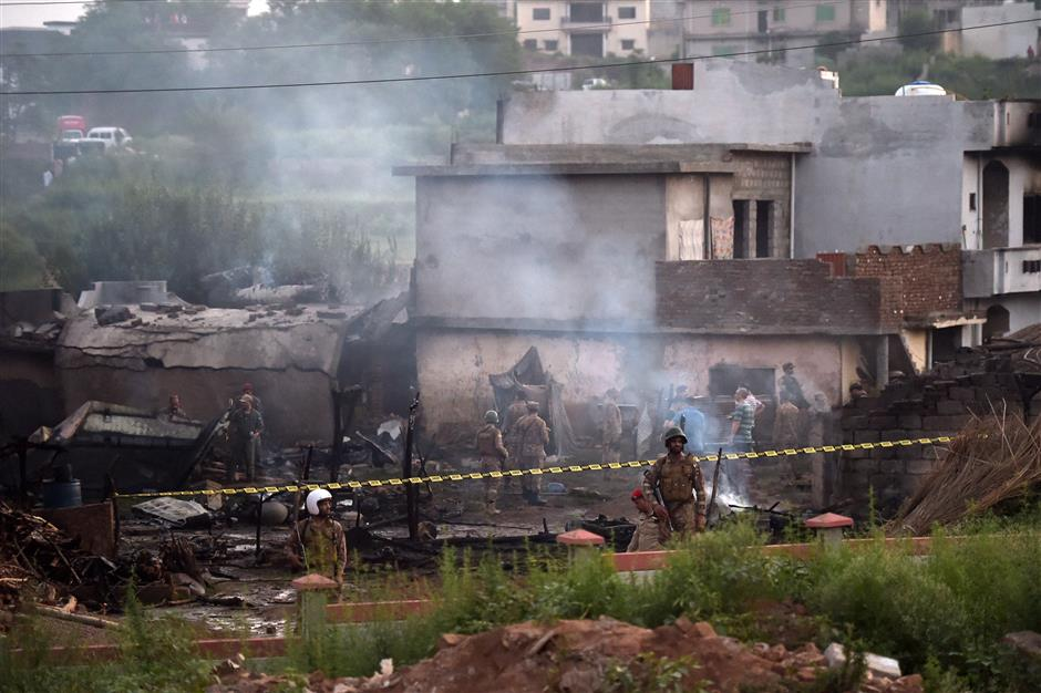 15 killed as Pakistani army plane crashes into residential area