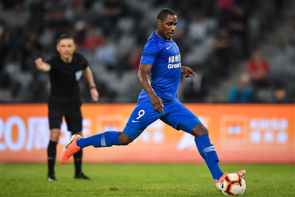 Shanghai Shenhua's Ighalo punished over social media use