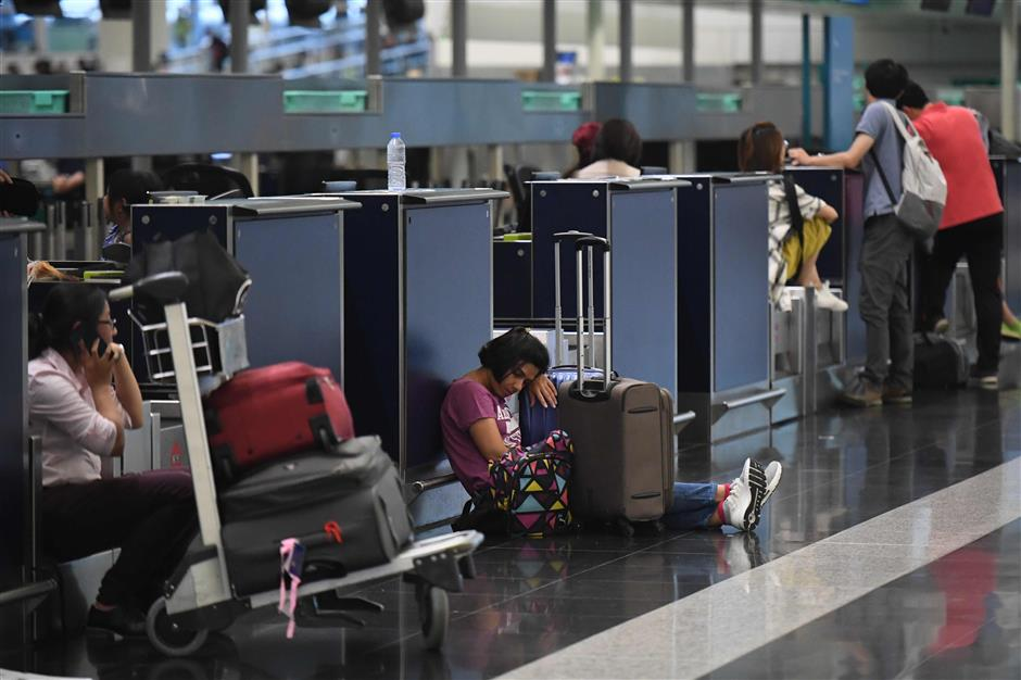 Hong Kong airport resumes operations with over 200 flights still cancelled