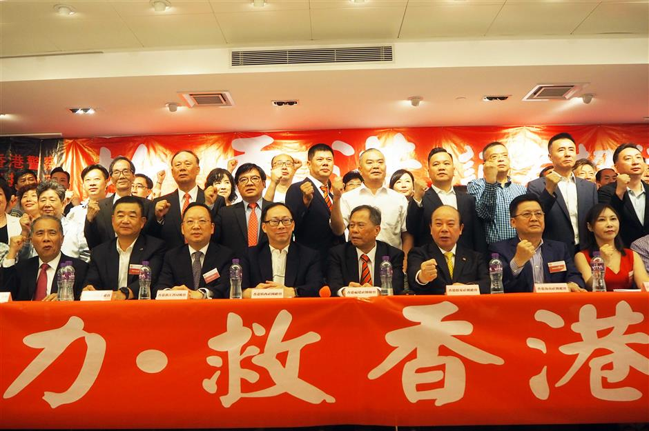Prominent businessmen call for jointly stopping violence, ending chaos in Hong Kong