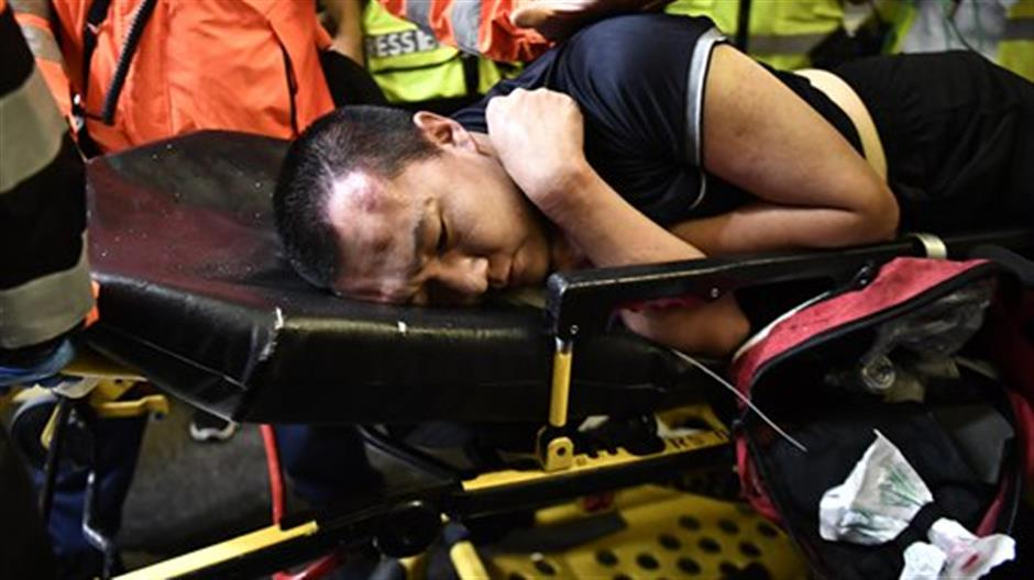 Hong Kong residents visit injured reporter, call for end of violence