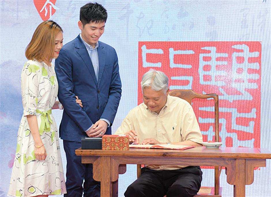Calligraphy masters present marriage certificates