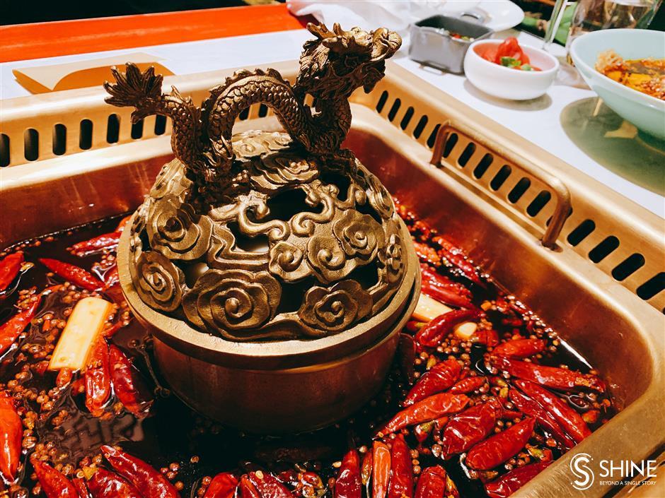 Enjoy spicy Sichuan hotpot and views over Bund
