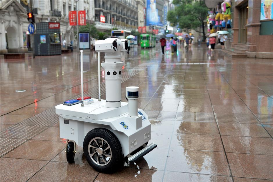 Police robot on patrol in the city