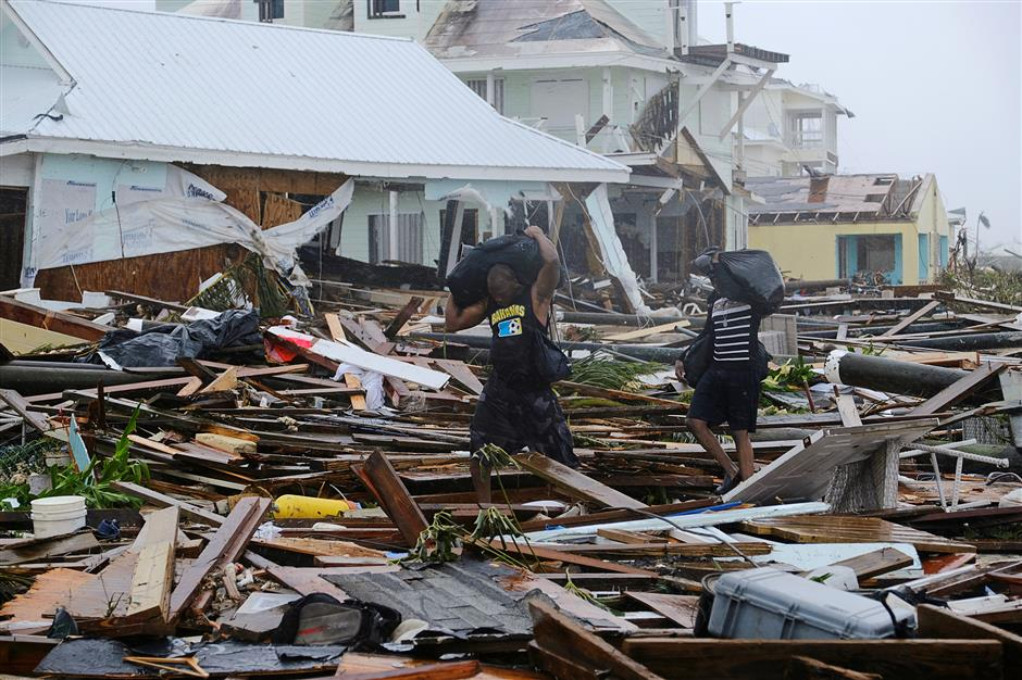 Bahamas staggers from Dorian's devastation, US southeast fears storm surge