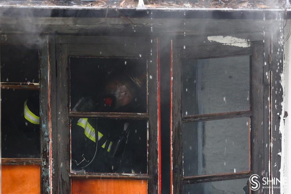 Historic shikumen blaze blankets Jing'an in smoke