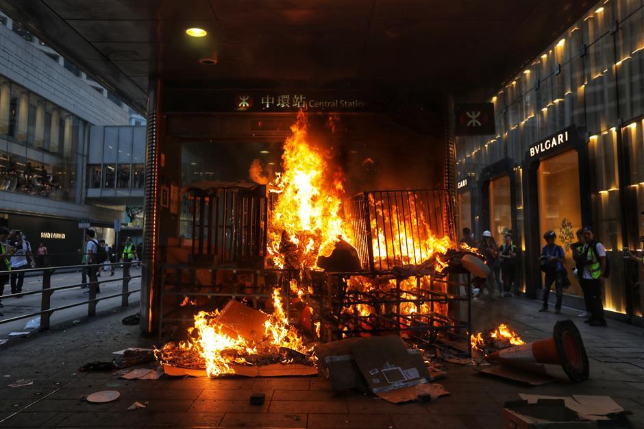 Radical demonstrators set fires on roads, MTR exit in central Hong Kong
