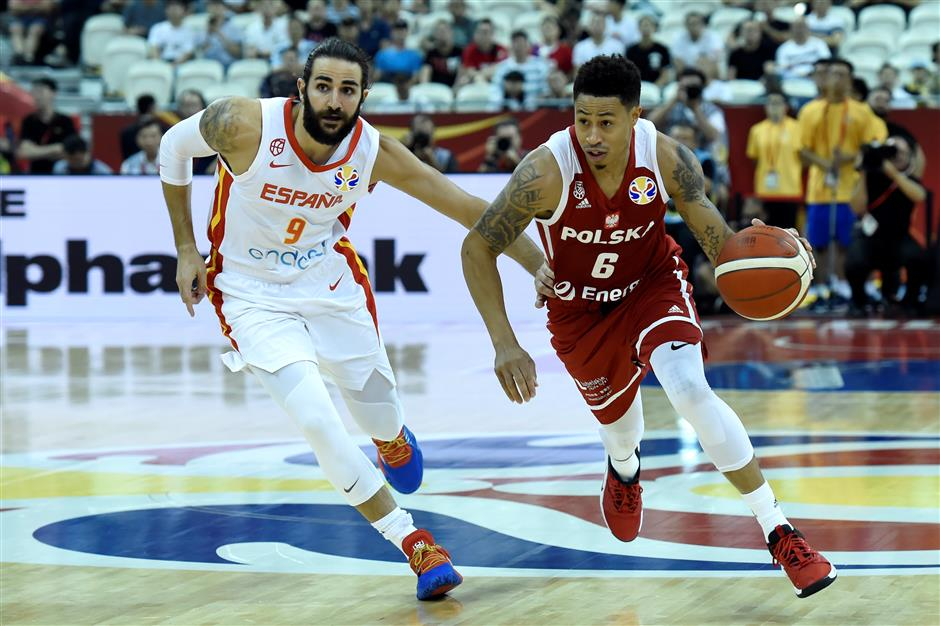 Rubio makes history to fire Spain as Argentina stuns Serbia