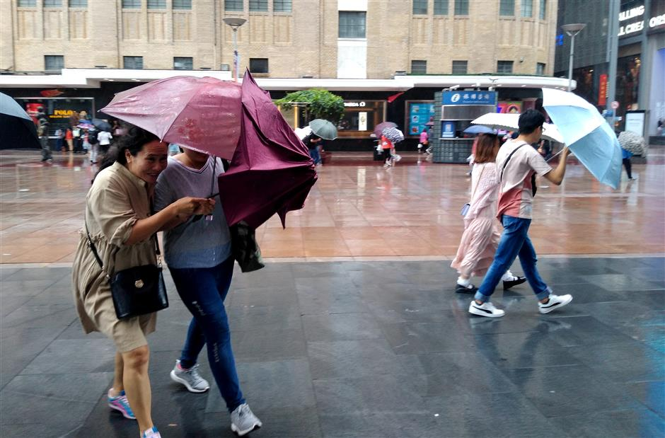 Typhoon Tapah soaks the city