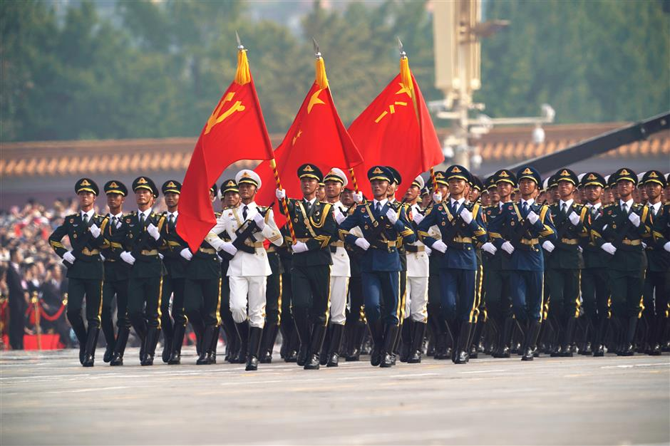 Xi reviews armed forces on National Day