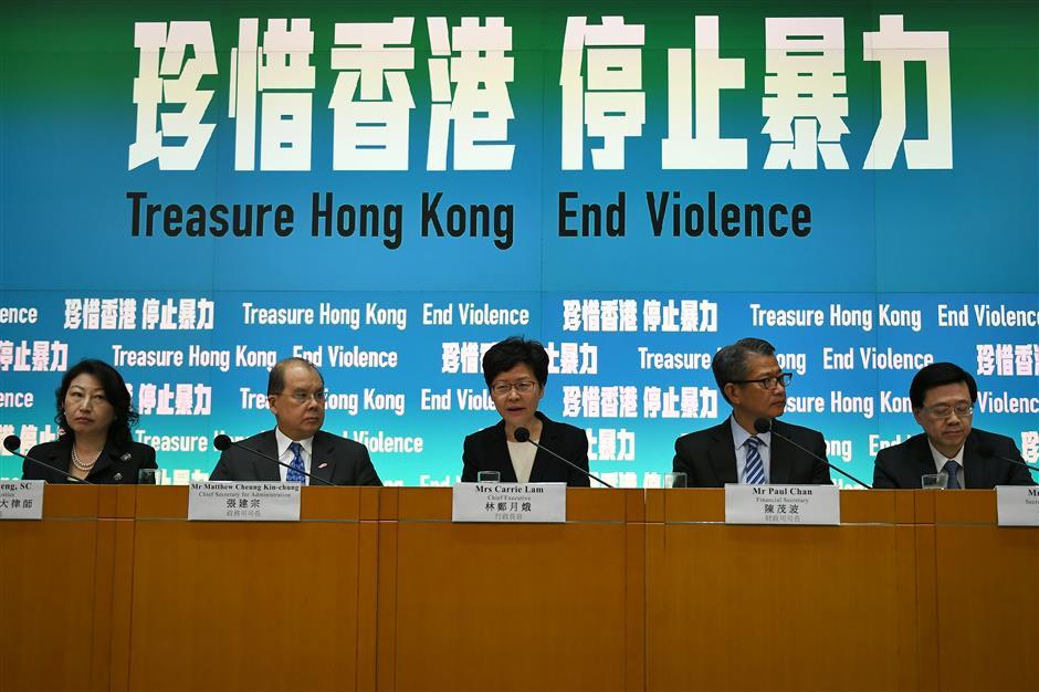 Unrest-hit Hong Kong outlaws wearing masks in violent protests
