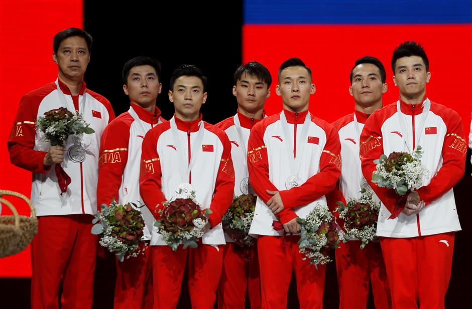 Russian gymnasts seize first men's team gold as China slips at the end