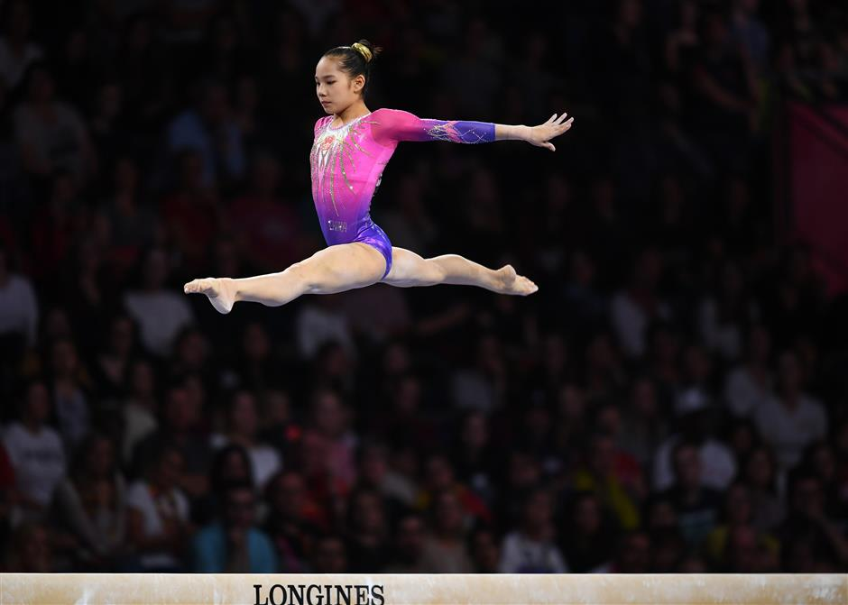 American gymnast Biles wins all-round, China's teenager Tang takes silver at worlds