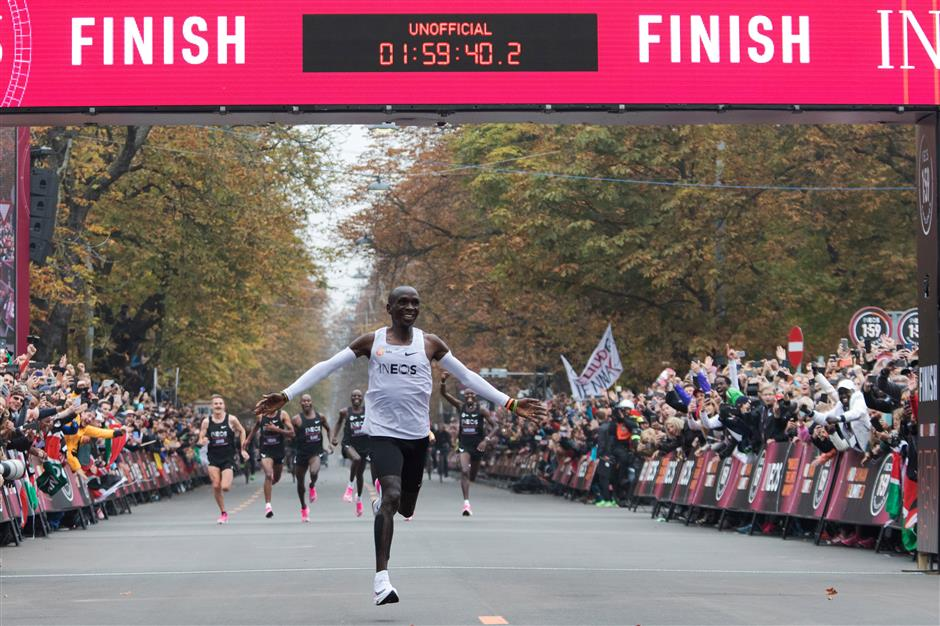 'Super-human' Kipchoge busts mythical two-hour marathon barrier