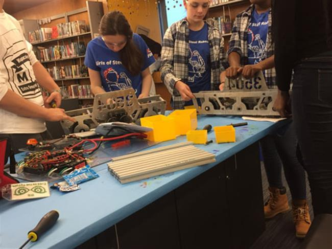 The Global Search for Education: How Building Robots Builds Confidence in Girls