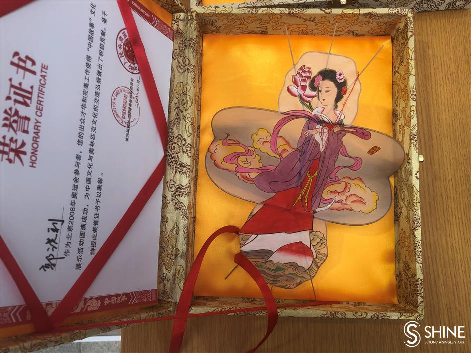 Guo flies a kite for Weifang culture