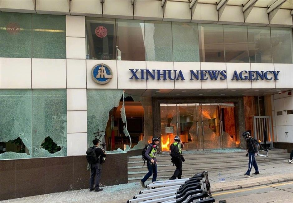HKSAR acting chief executive condemns rioters' vandalism against Xinhua's office in HK