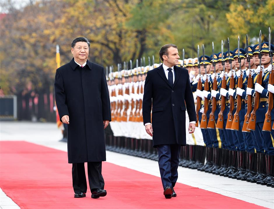 China, France sign deals worth US$15b, defend Paris climate pact