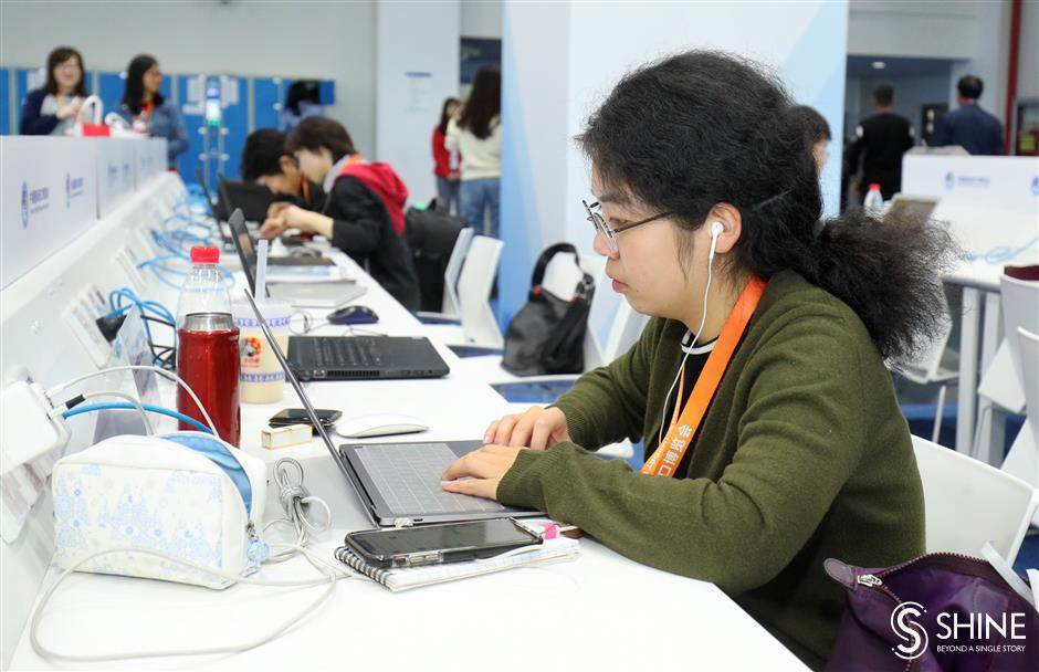 Happy Journalists' Day: day 4 of CIIE through Shanghai Daily's lens