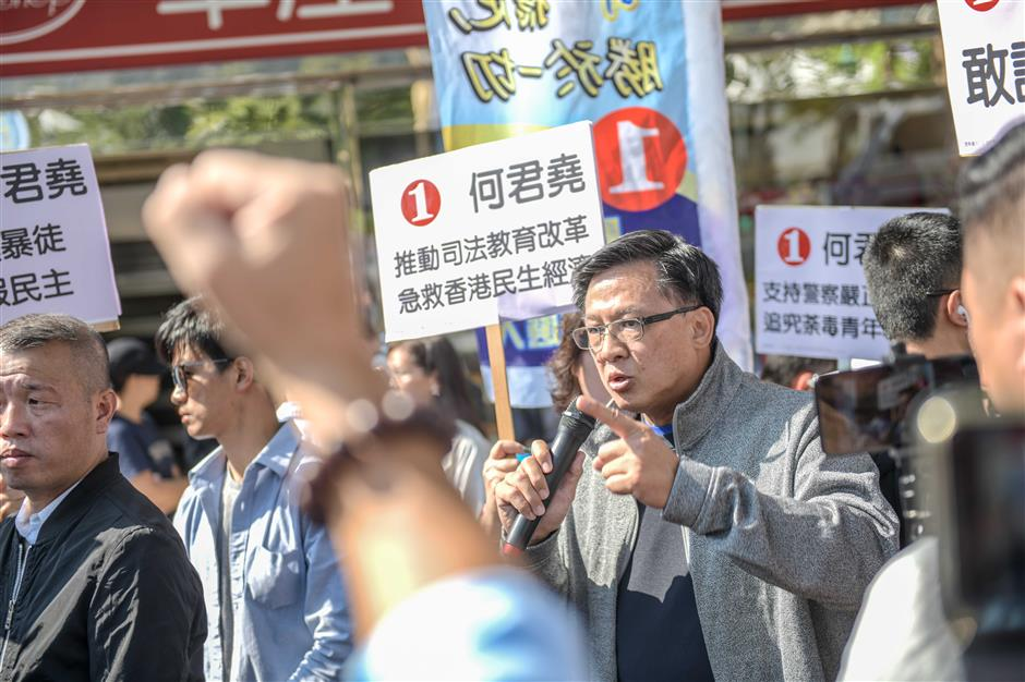 Stabbed HK candidate returns to campaigning