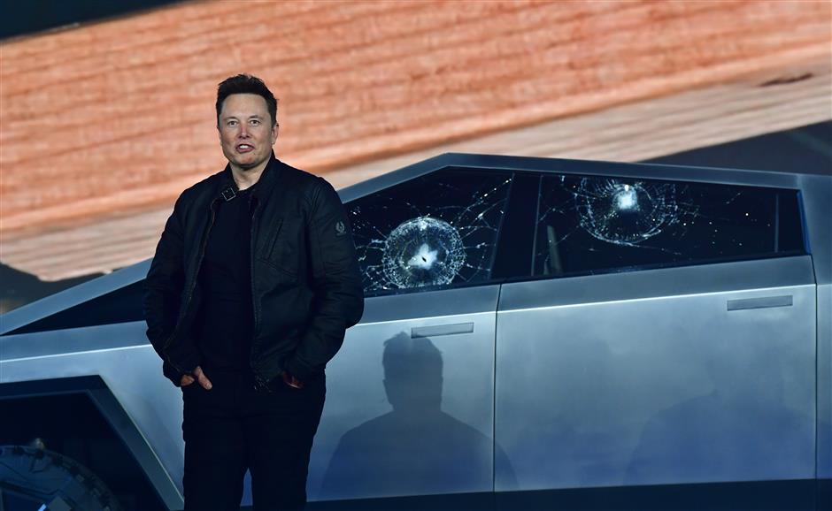 Tesla suffers broken glass mishap during chaotic launch