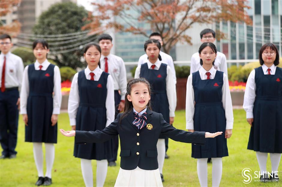 Macau students sing of unity