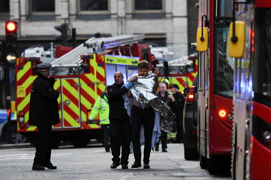 Knifeman shot dead at London Bridge, incident treated as terror-related