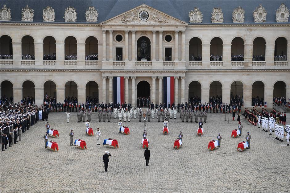 Macron honors 'sacrifice' of 13 French soldiers killed in Mali