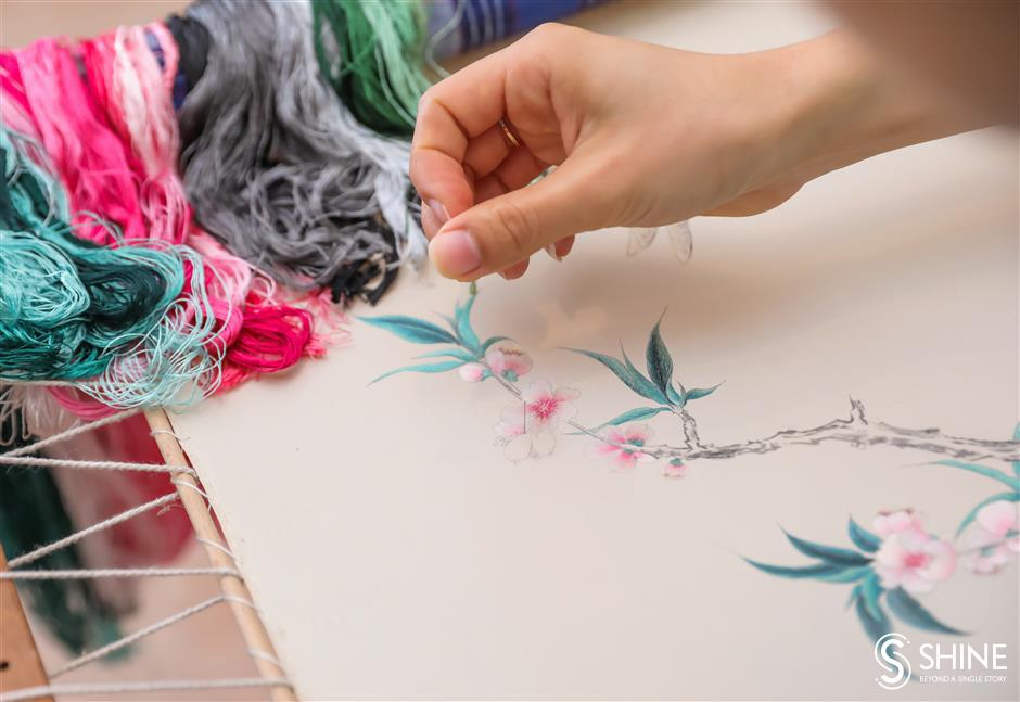 Gu-style embroidery stitches up in Milan