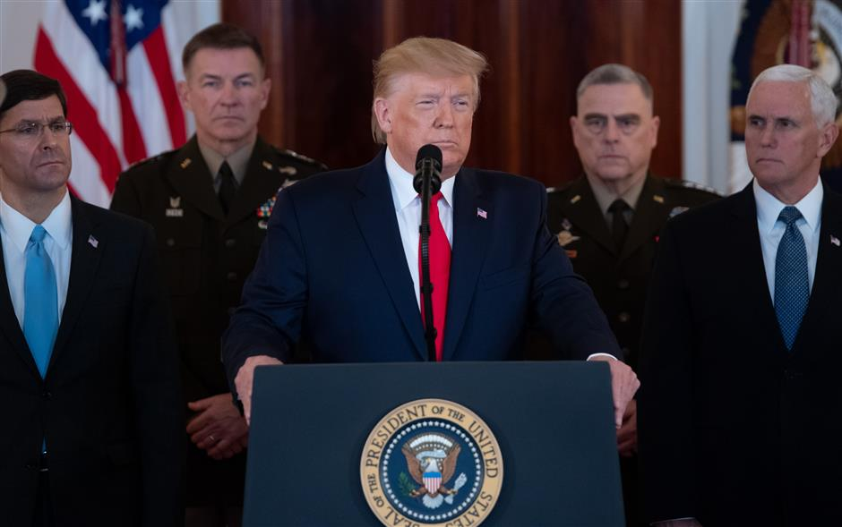 Trump says no US troops hurt in Iran strikes, Tehran standing down