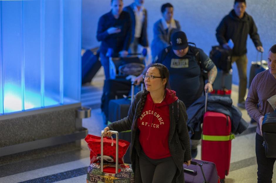 US starts screening Chinese passengers at 3 airports