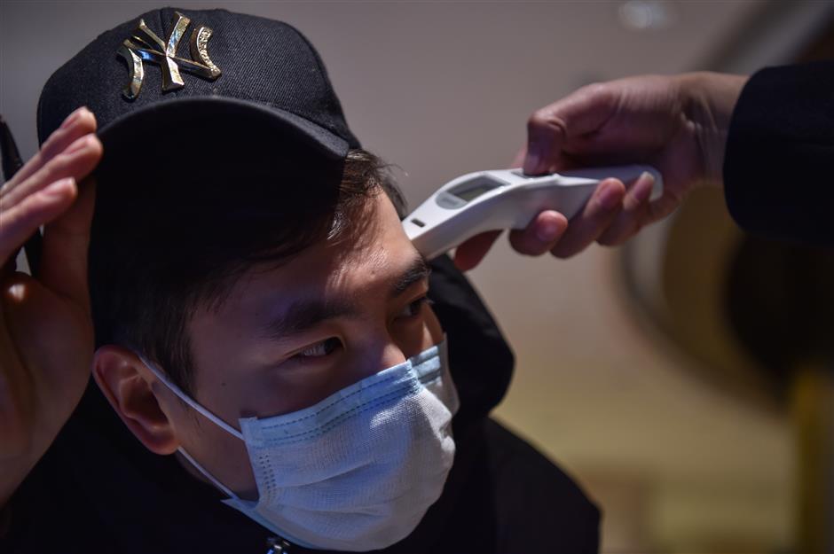 China's Hubei reports 1,032 new confirmed cases of novel coronavirus