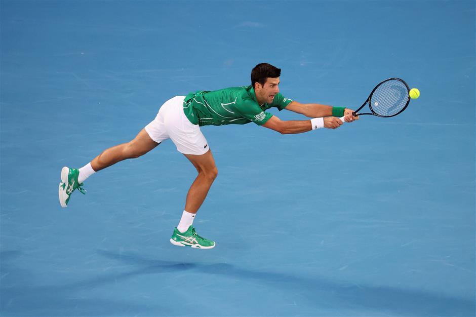 Djokovic beats Thiem in five-set epic to win eighth Australian Open