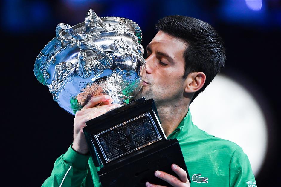 Novak Djokovic captures record eighth Australian Open victory with desire, mental strength
