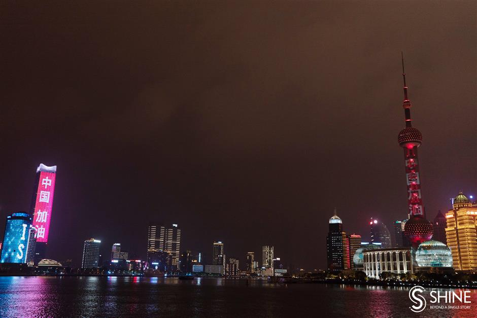 Both sides of the Huangpu River light up in support of Wuhan