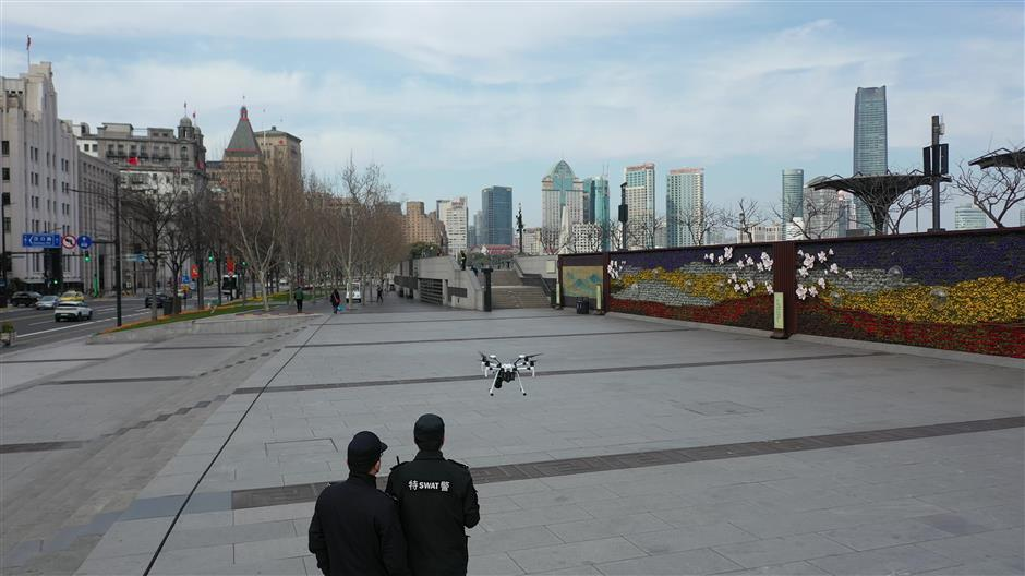 Police in Huangpu use drone and robot to send mask reminders