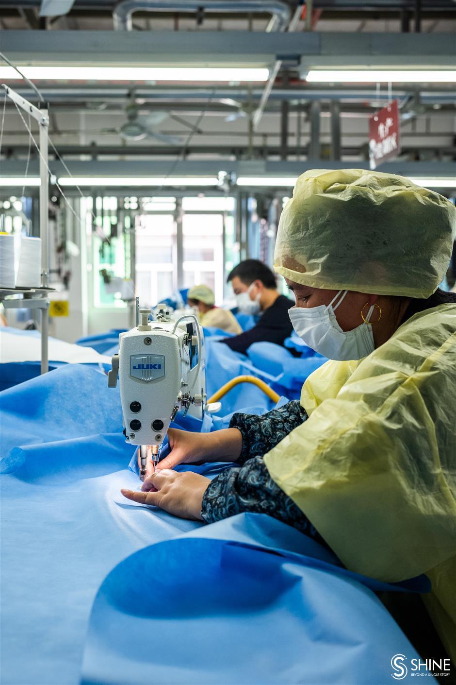 Volunteers helping in packing medical wear