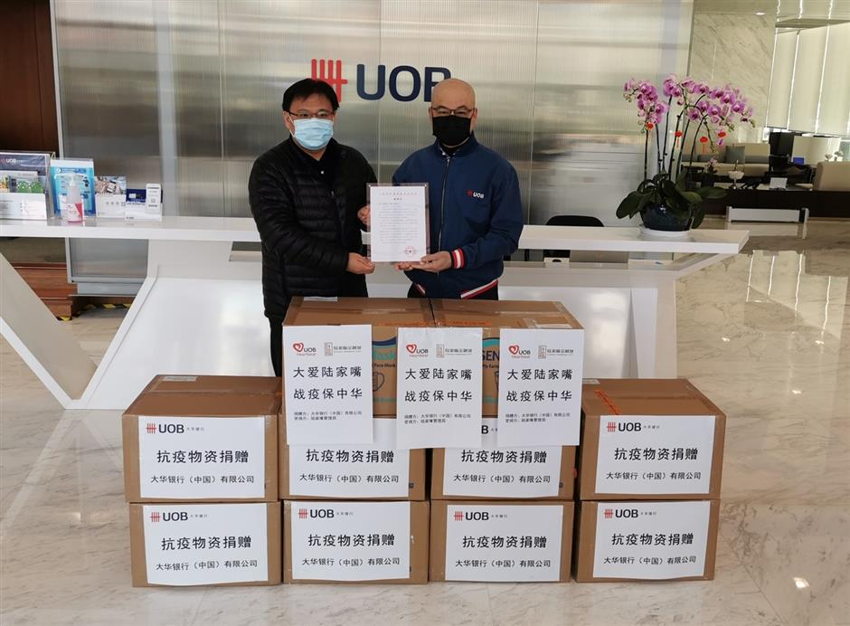 Bank gives 100,000 masks for virus fight