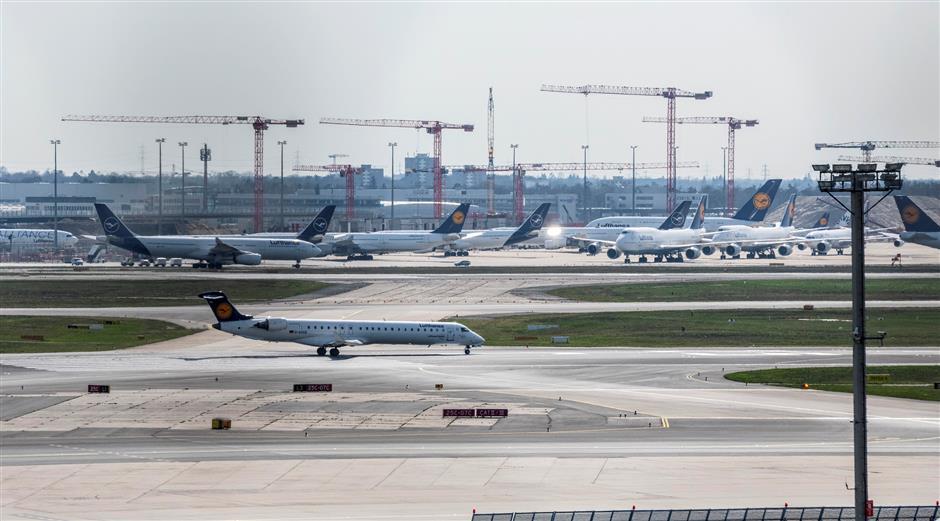 Global airlines slash flights as US carriers seek US$50b bailout