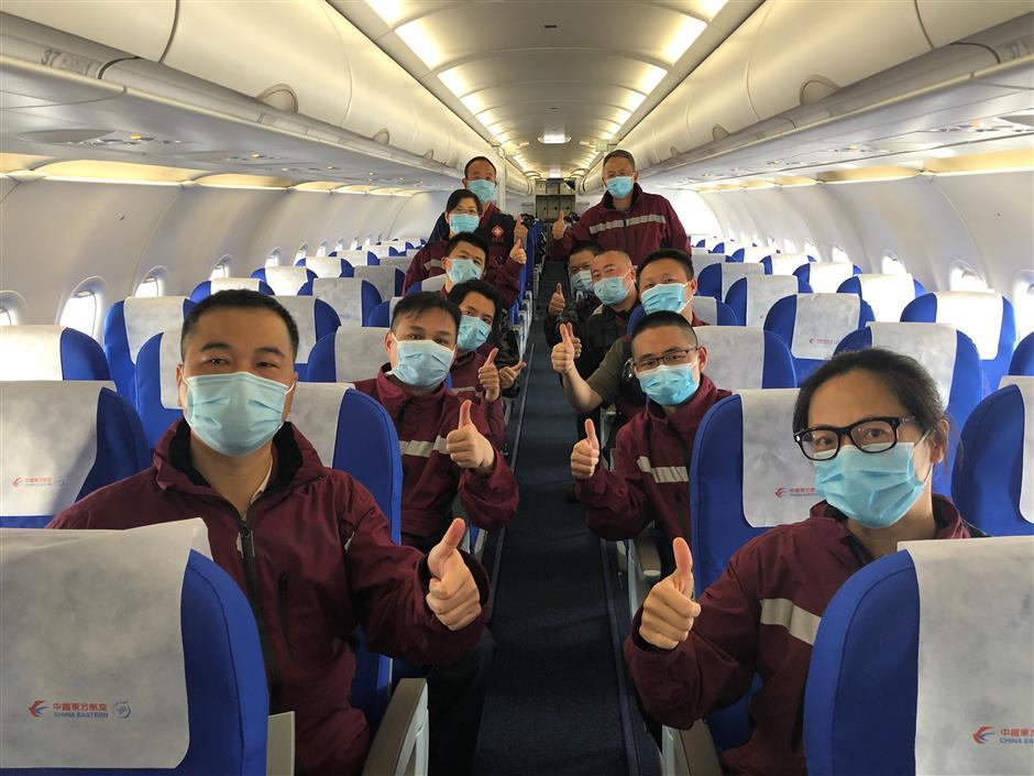 Shanghai's heroes arrive home from Wuhan