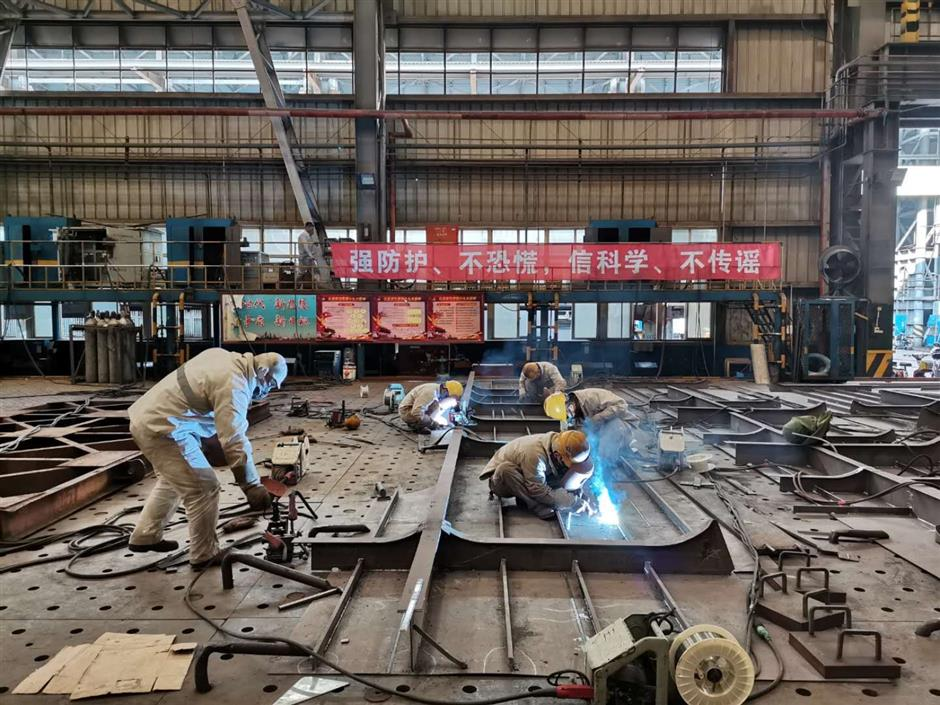 Pudong firms returning to normal working